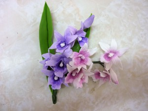 Flor cenografica arranjo mini orquideas rosas lilas